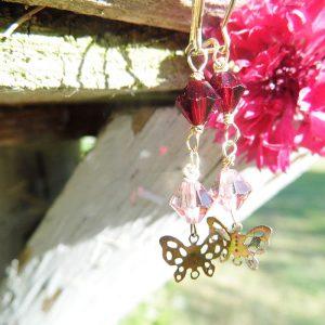 Øreringe forgyldte med sommerfugl og swarowski