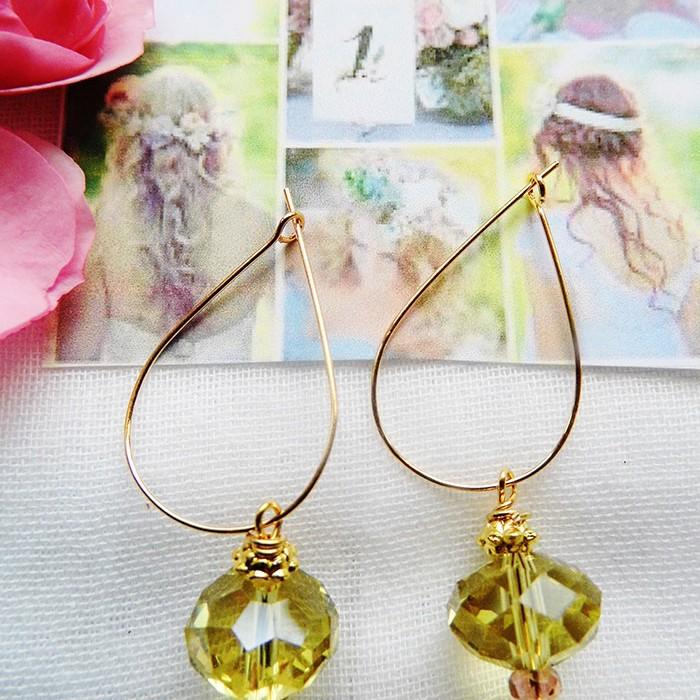 Øreringe med oliven grøn krystal til den feminine kvinde